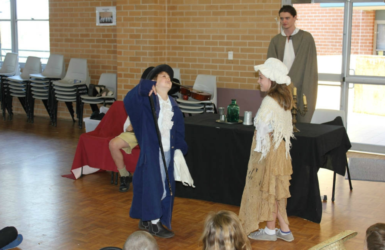 Children acting out the characters in the Colonial Adventure experience School Holiday Program for V